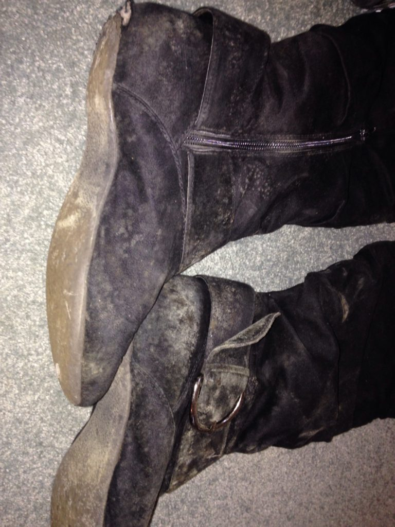 black mould growing on leather boots